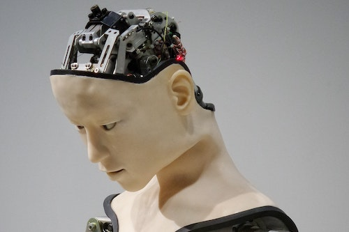 robot head with machinery revealed